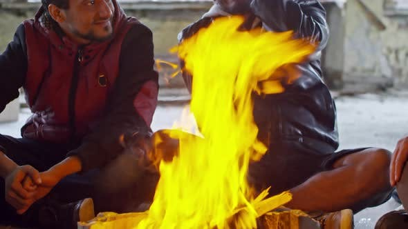 Thumbnail for Cheerful Arab Men Sitting by Fire