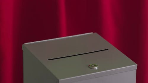 Putting ballot into voting box, election concept