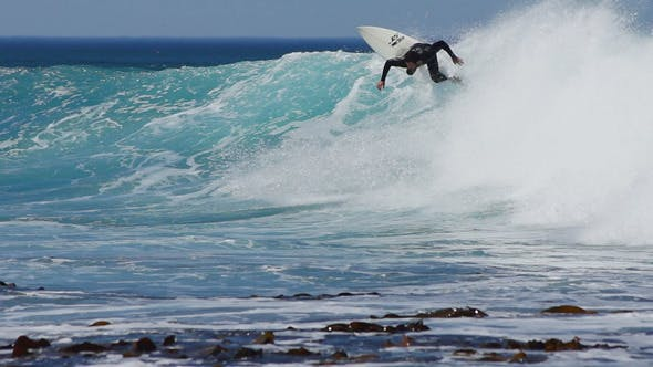 Surfer In Motion