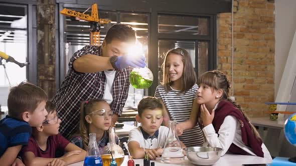 Thumbnail for Six Young Caucasian Children with Teacher Working with Chemical Reactions at Chemistry Lab