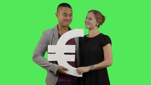 Couple holding euro symbol