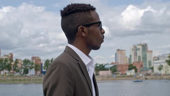 Thumbnail for African Businessman Walking along Riverside