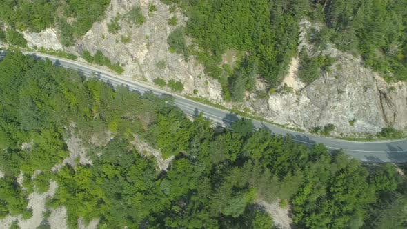 Thumbnail for Chasing Silver Car on Rocky Mountain Passage Road in Bulgaria
