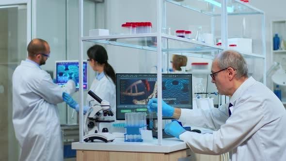 Thumbnail for Elderly Man Technologist Doing Laboratory Test