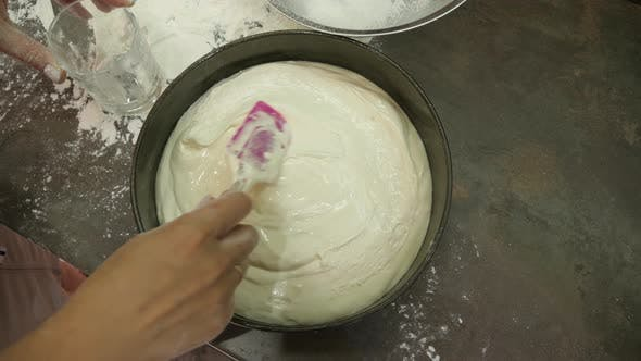 Arranging the cake batter into the baking pan