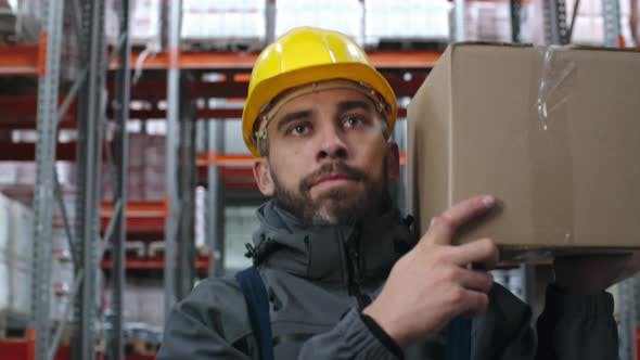 Thumbnail for Male Worker Carrying Cardboard Box