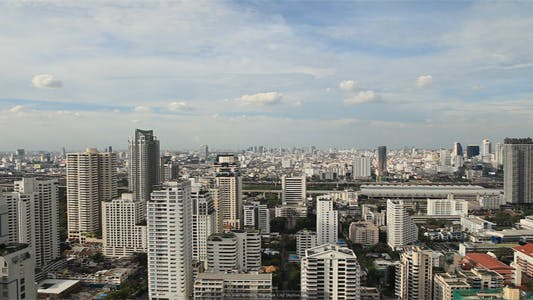 Thumbnail for Pan Over Modern Bangkok City Skyline Day