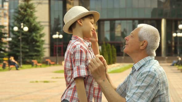 Thumbnail for Senior Man Hugs His Grandson