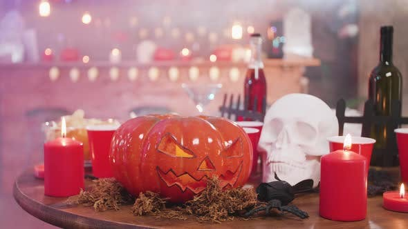Thumbnail for Carved Pumpkin As a Halloween Still Life and Other Decor Elements in a Bar