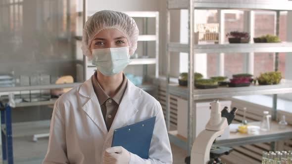 Thumbnail for Portrait of Female Biologist Holding Documents Folder