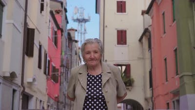 Old Woman Traveler Walks About Streets in Chioggia
