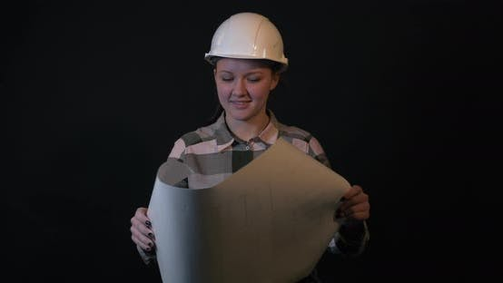 Thumbnail for Young Female Engineer Is Studying a Construction Plan