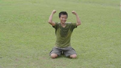 Boy Celebrating A Goal