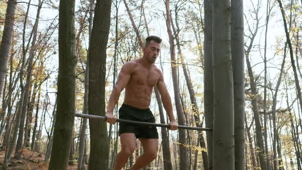 Thumbnail for Strong Naked Guy Pulls Up On Pole. Exercise Emphasizes All The Muscles Of The Man.