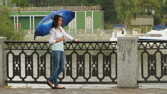Cover Image for Beautiful Girl Posing With Umbrella