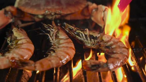 Butter on Giant Shrimp on the Grill
