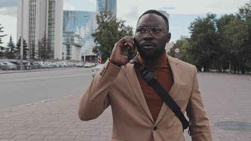 Businessman Making Phone Call Outdoors