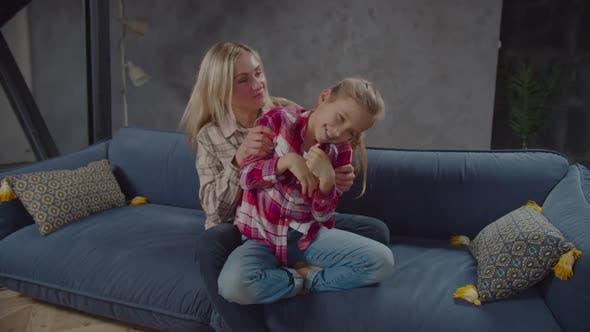 Thumbnail for Joyful Mum and Cute Daughter Bonding on Sofa