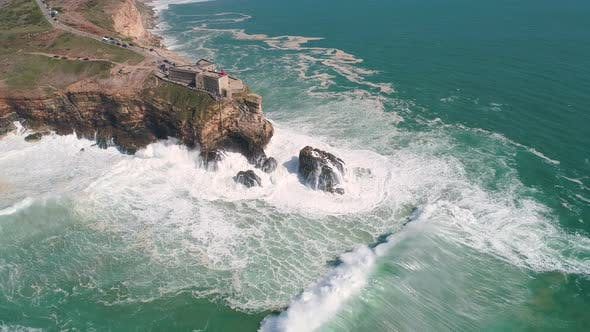 Thumbnail for Flight near Rock and Lighthouse near City of Nazare