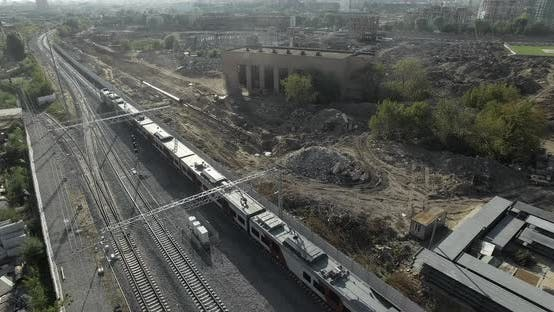 Cover Image for Train in City Outskirts, Aerial