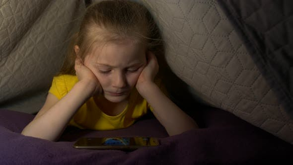 Thumbnail for Little Girl With Phone On Bed