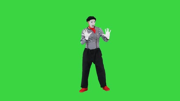 Mime Leans To Invisible Wall on a Green Screen Chroma Key