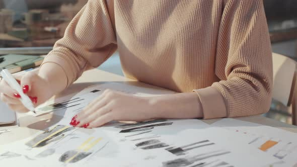 Thumbnail for Female Designer Drawing Fashion Illustrations at Desk