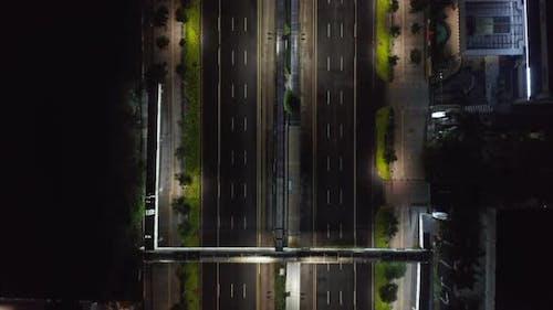 Top Down Overhead Aerial View of Empty Multi Lane Motorway at Night During Coronavirus Lockdown in