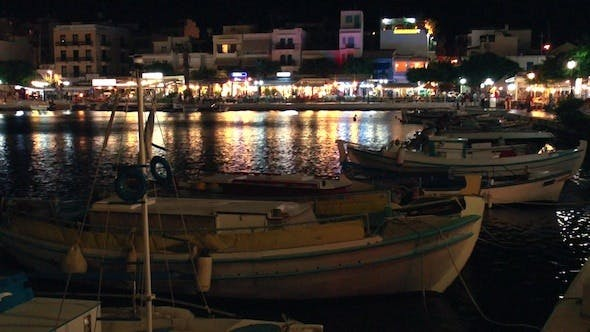 Cover Image for Boats In Voulismeni Lake At Night, Aghios Nikolaos
