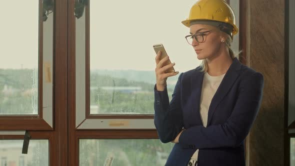 Thumbnail for Entrepreneur on Construction Site Using Smartphone