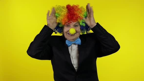 Thumbnail for Senior Old Woman Clown in Colorful Wig Smiling, Making Silly Faces, Fool Around