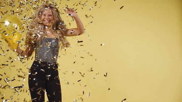 Thumbnail for Curly Haired Molde Dancing with Yellow Confetti and a Balloon in Her Hands