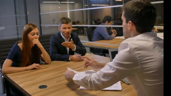 Thumbnail for Attractive Businesspeople Meeting in Office Boardroom