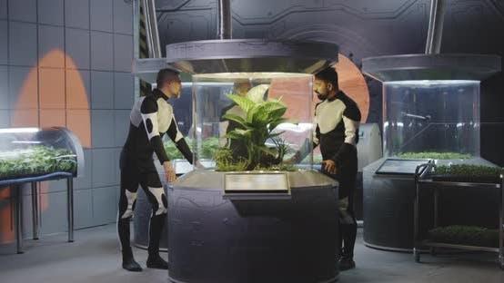 Astrobiologists Examining Plant Incubator
