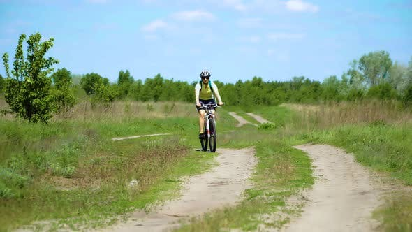 Thumbnail for Woman Cyclist Moving On Bike On Countryside