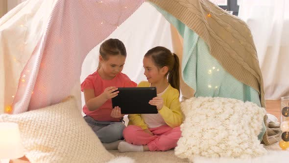 Cover Image for Little Girls with Tablet Pc in Kids Tent at Home