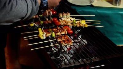 grilling barbecue pork stick in street market