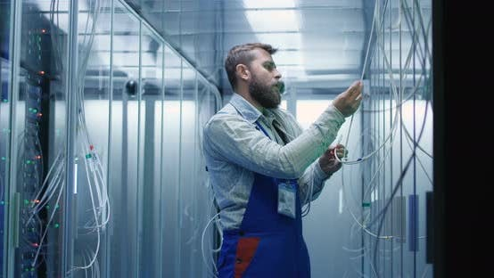 Thumbnail for Male Technician Checking Cables in a Data Center
