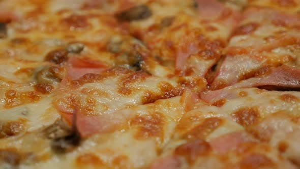 Thumbnail for Bacon and chamignons spreaded on tasty baked pizza surface  panning 4K 2160p 30fps UHD video - Slow