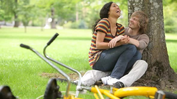 Thumbnail for Couple sitting together at park