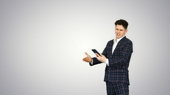 Cover Image for A young businessman dancing after he argues on the phone