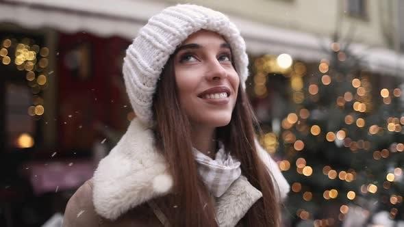 Thumbnail for Girl Enjoying Snowfall on the Street