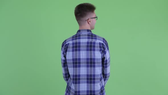 Thumbnail for Rear View of Young Hipster Man Thinking and Looking Around