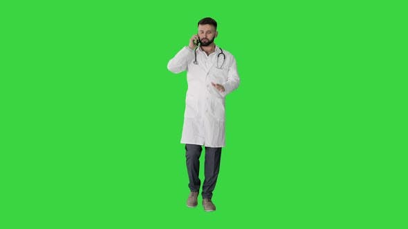 Thumbnail for Medical Doctor Calling By Phone Walking on a Green Screen, Chroma Key