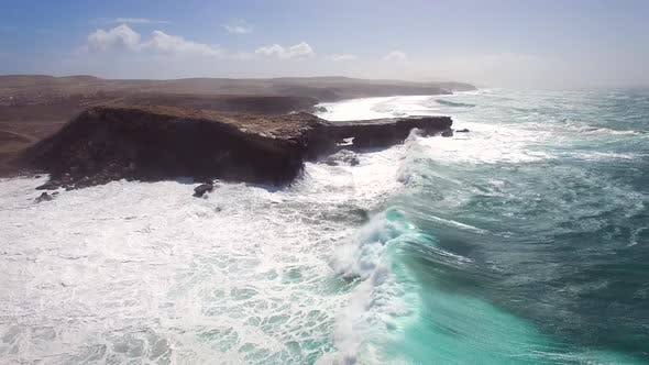 Aerial view of waves crashing of the rocks of punta Guadalupe in Fuerteventura.