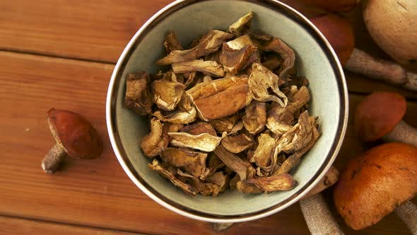 Thumbnail for Dried Mushrooms in Bowl on Wooden Background
