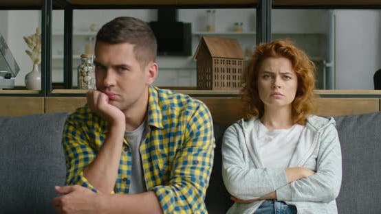 Portrait of Young Sad Man and Angry Woman, Woman Is in Focus
