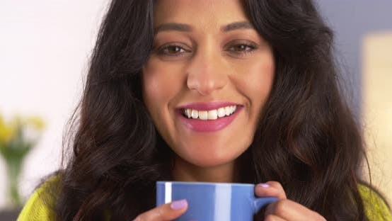 Thumbnail for Silly Mexican woman smiling and holding mug