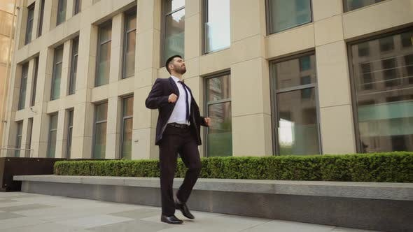 Thumbnail for Happy Businessman Is Dancing on the Street Near the Office Center Wearing Suit Celebrating