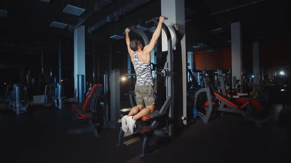Thumbnail for Athlete Doing Workout Pull Up Training Hands And Shoulders on Weights Lifting Exercise Machine Gym